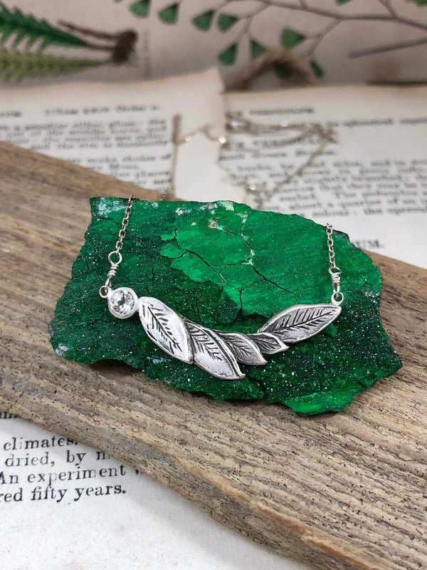 Carved Leaf Necklace With White Topaz
