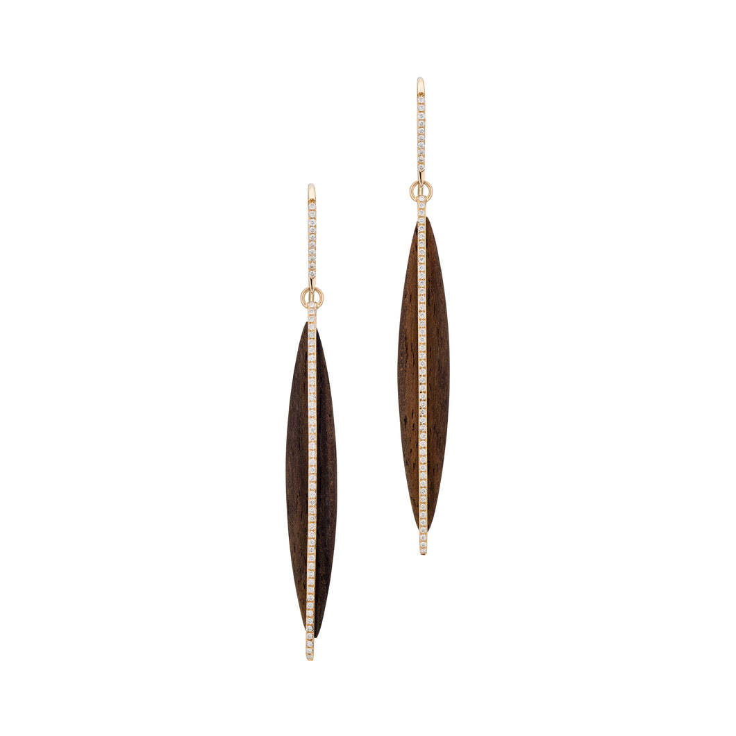 Hand carved long ebony wood earring caged in 18K rose gold with white diamonds