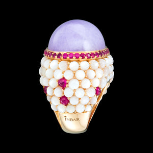 A large center stone, cabochon cut, 18k gold, lavender jade with rubies and mother of pearl.