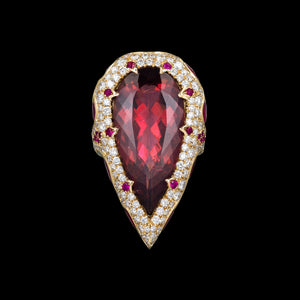 Red tourmaline, rubellite, set in a 3D nest of diamonds and rubies