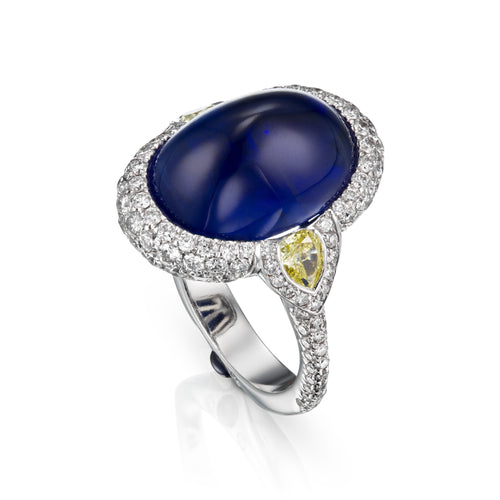 GRS certified 13.57 carat royal blue Suferloaf sapphire ring with white and fancy yellow diamonds, white 18k gold and small sapphires.