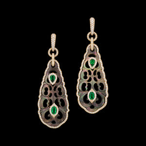 Hand carved Tahitian M.O.P with green tsavorite set in rose 18k gold with diamonds.