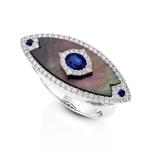 East west Mother of pearl and diamond ring set with a center sapphire.
