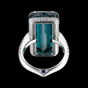 Blueish green center Tourmaline ring set in 3D with diamonds, sapphires and small tourmaline.