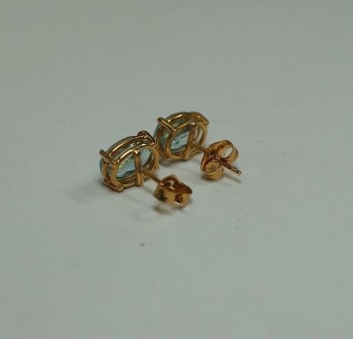 Ladies Pair of 14K Yellow Gold Oval 6x8mm Aquamarine Earrings