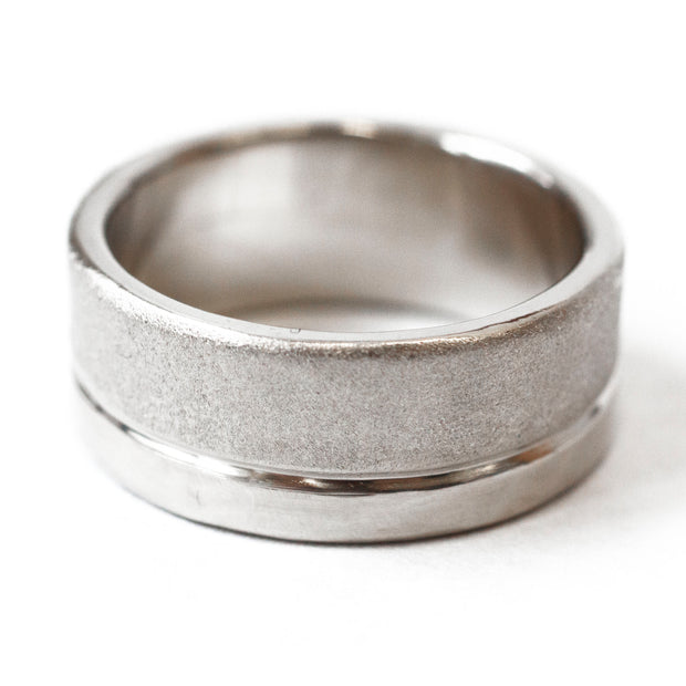 white gold wedding band with two textures--7mm with 5mm brushed matte and 2mm polished
