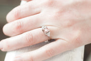 Pink Princess Cut engagement ring with handcut white sapphire triangle side stones. Handmade in Vermont.