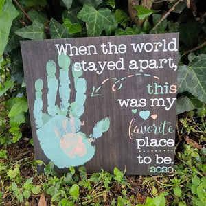 """When the world stayed apart"" with layered handprints 12"" x 12"" Unframed or 12"" Round Sign"