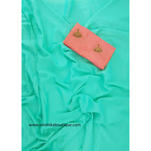 Blue color Jute silk plain saree with Jute silk buttis designer blouse - Vinshika