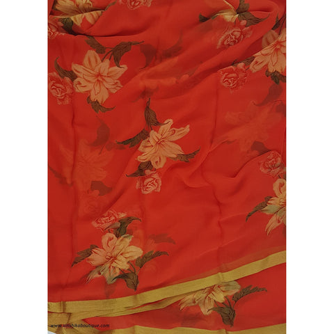 Orange color pure floral chiffon saree with golden zari border
