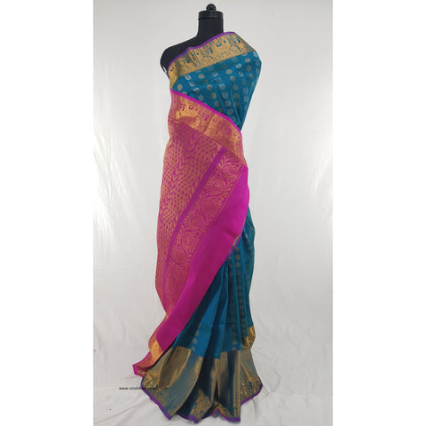 Peacock Blue and Pink color Handwoven Kuppadam Pattu Golden Zari Heavy Kanchi border Saree - Vinshika