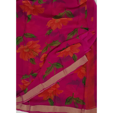 Pink color floral chiffon saree with golden zari border