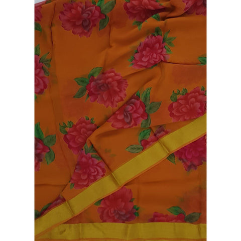 Orange color floral chiffon saree with golden zari border - Vinshika