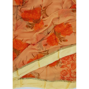 Saffron color floral chiffon saree with satin border
