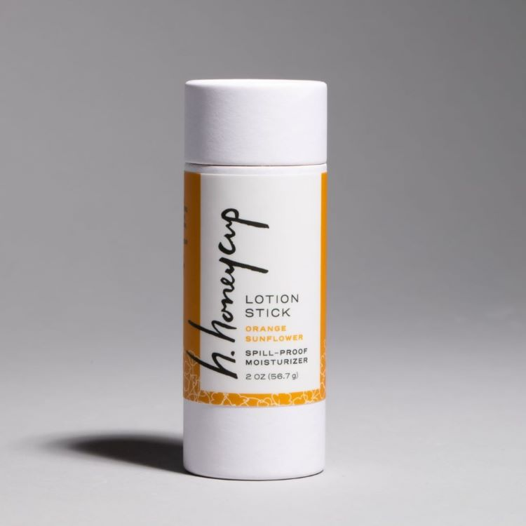 Image of H. Honeycup natural orange lotion stick for blog describing how a lotion stick is applied to the body.