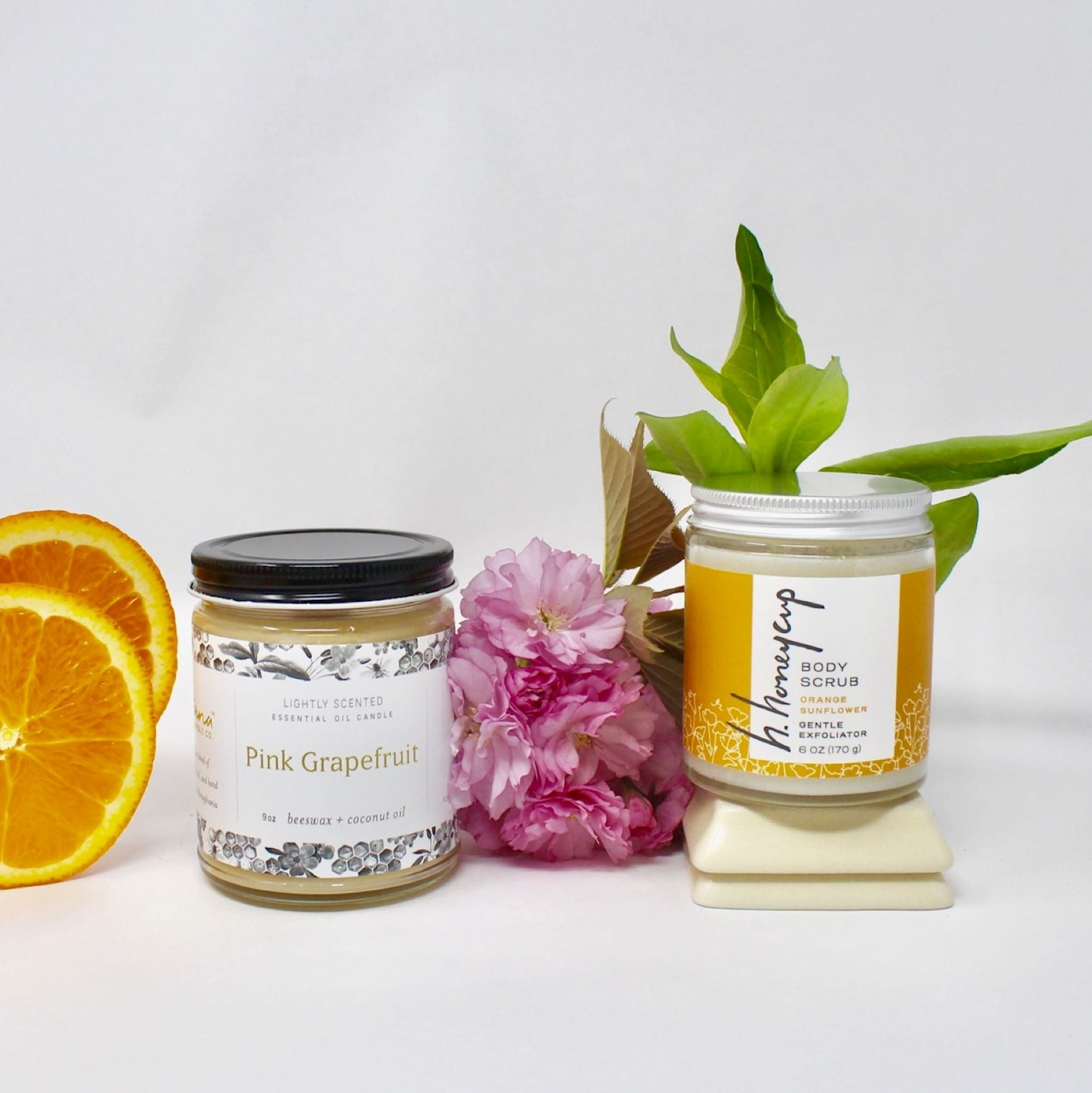 Citrus set with one 6 oz orange body scrub and one 9 oz pink grapefruit candle