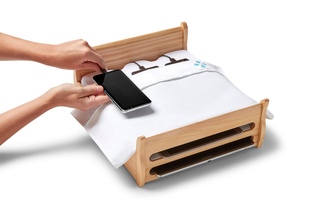 Arianna Huffington's Phone Bed Charging Station, brought to you by Thrive Global