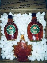 Glass bottles of syrup in packing peanuts