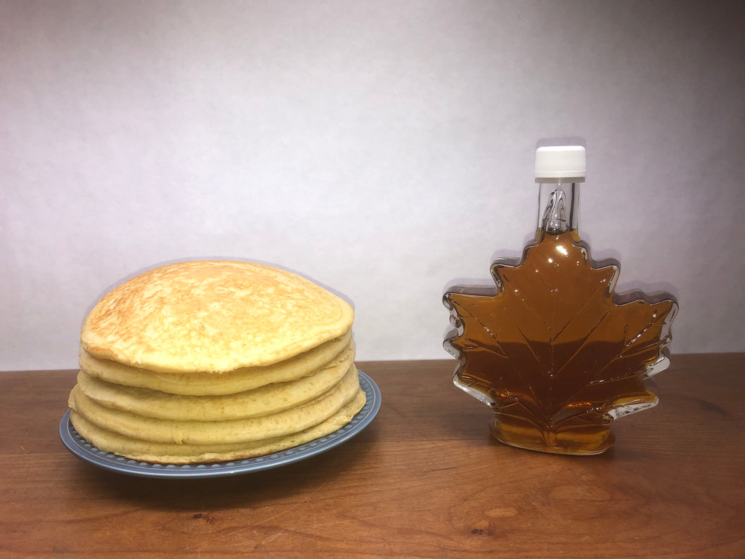 250 ml of Maple Syrup in a Maple Leaf shaped glass container
