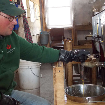 Josh pouring off processed syrup