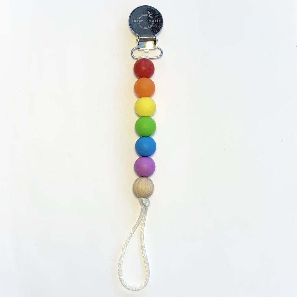 Sugar + Maple Pacifier + Teether Clip- Silicone with 1 Beechwood Bead - Rainbow Primary