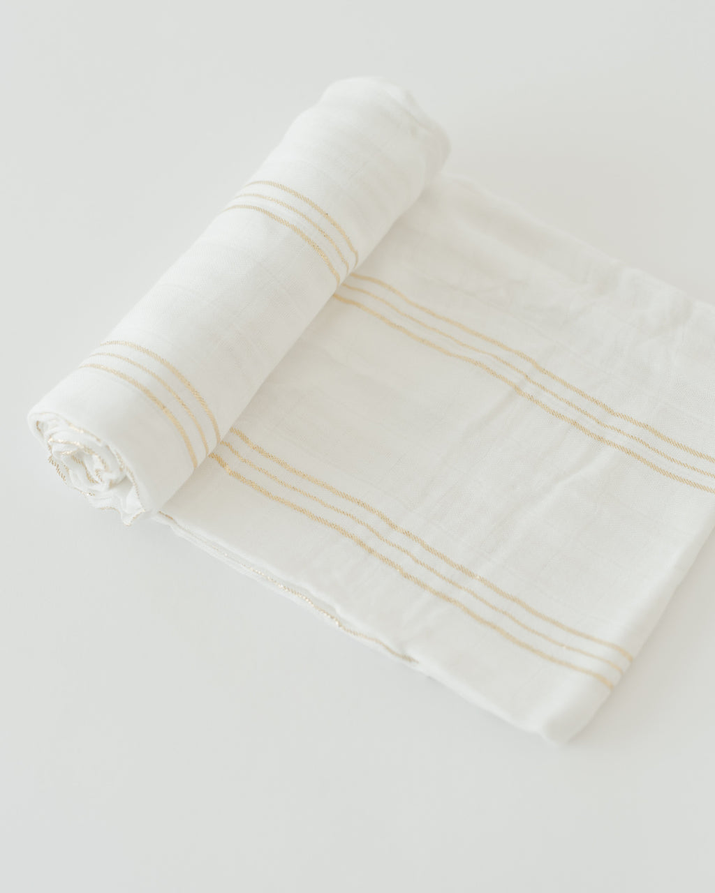 Little Unicorn Deluxe Swaddle - Gold Stripe