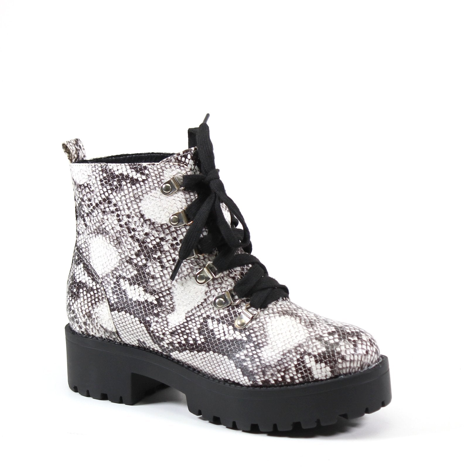 A vegan leather croco print ankle boot with a buckle ornament ankle strap, low block heel and inside zip is so stylish and sleek.  A pointed toe design completes this polished European inspired style.