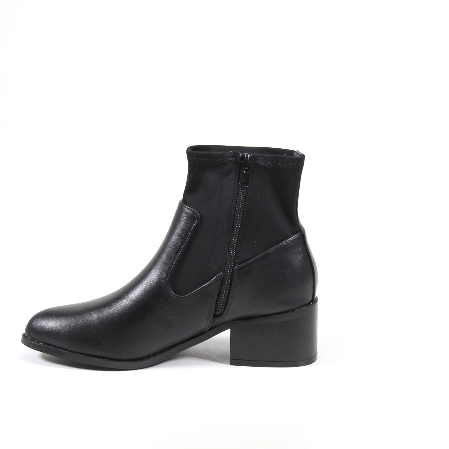 An over the ankle-high bootie featuring an imi leather vamp and stretch Lycra panel for a European inspired look. ALLY INN features an almond toe and inside zipper for a polished look.