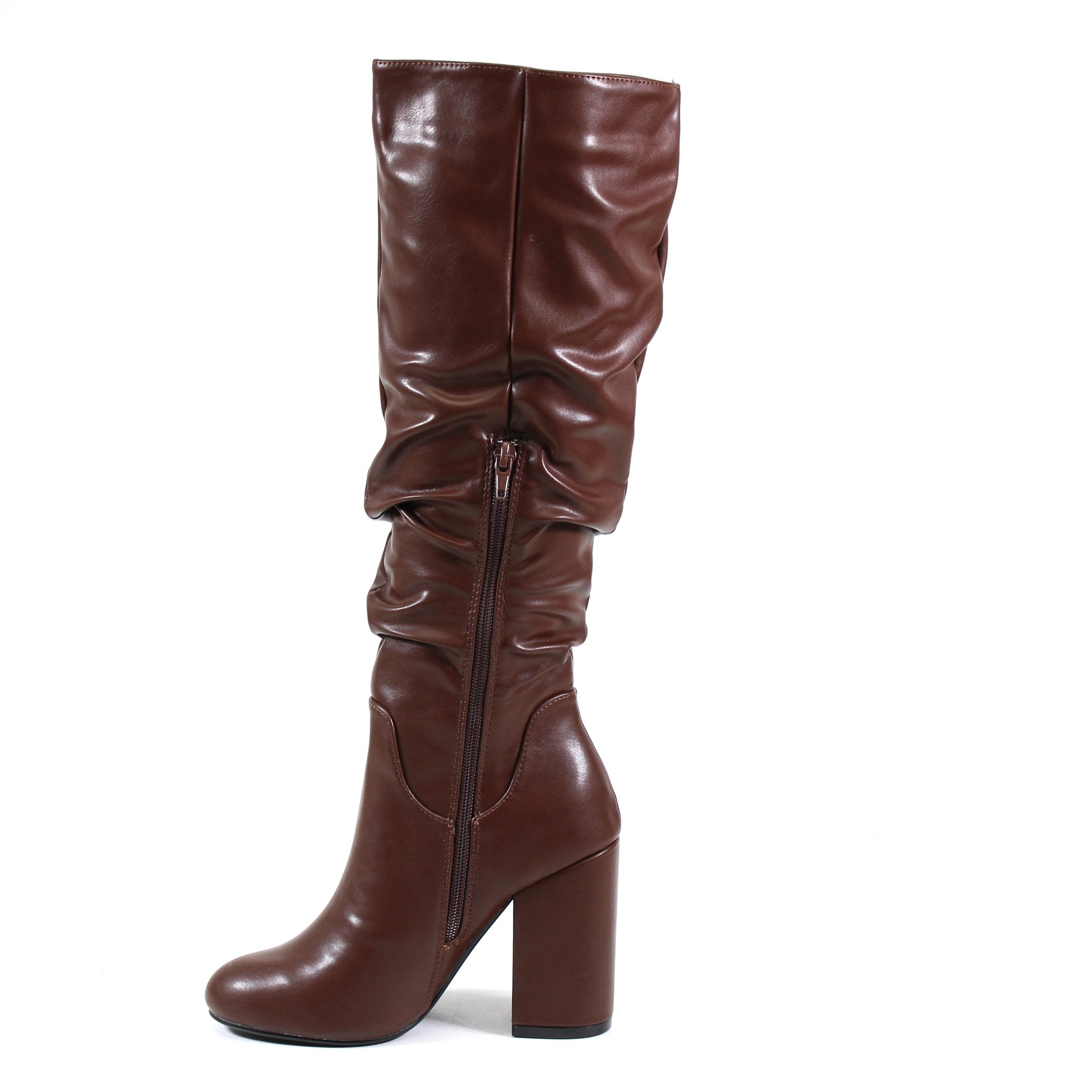 A DANA by Diba London is a mid-length slouch boot perfect for your casual or work looks.  Chocolate Vegan Leather or Tan Immi Suede covers the upper with an almond toe finish. Instant, effortless style with a self-covered block heel and partial inside zip