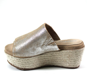 This espadrille-inspired platform takes this style to new heights with layers of artfully-braided jute wrap this espadrille platform sandal that features a classic buttery soft suede upper. The cushioned footbed adds maximum comfort to complete this minimal slide sandal.