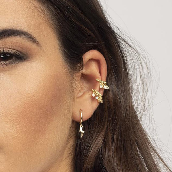 Lightning Bolt Huggie Hoop Earrings from Empty Whole™ Jewelry.