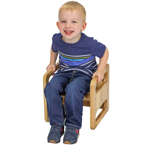 Toddler sitting on a cube chair