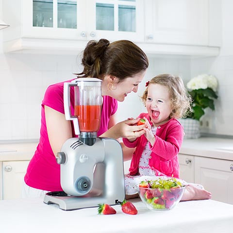 Child making a smoothie