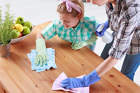 Cleaning kitchen with kid