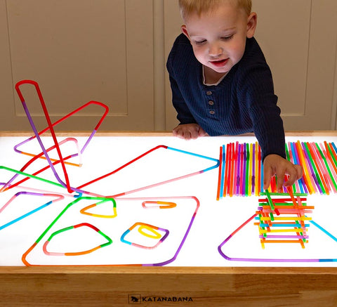 Building with colored straws on light table
