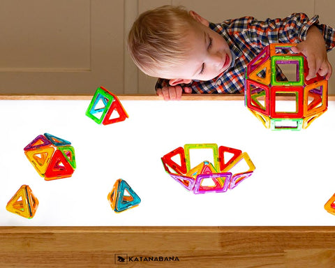 Magnet building toy on light table