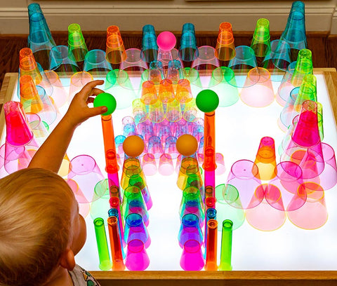 Translucent cup castle on light table