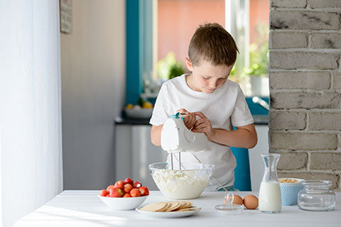 Kid cooking with mixer