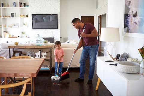 Child sweeping and cleaning