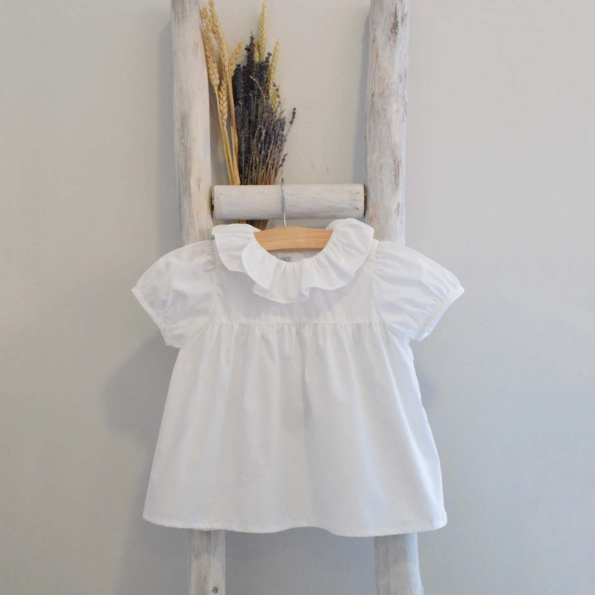 Pukatuka Short Sleeve White Ruffle Top