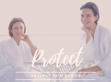 Two Beautiful women in white bathrobes at spa. Mikel Kristi Healthy Skin Basics; Protect