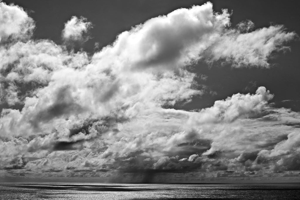 KaneSkennar-Large clouds over the ocean in bw