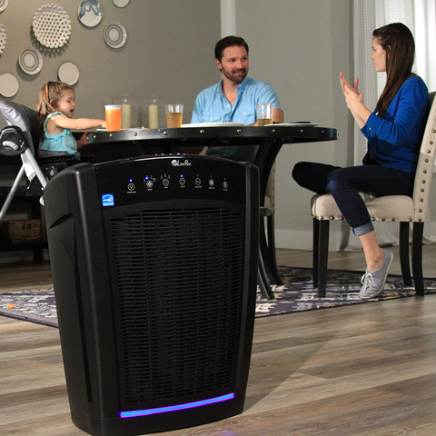 LivePure Bali Air Purifier in dining room with family eating dinner