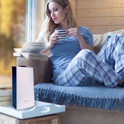 LivePure Ultrasonic Cool Mist Tabletop Humidifer LP450HUM Sitting on Table While Girl Relaxes and Reads