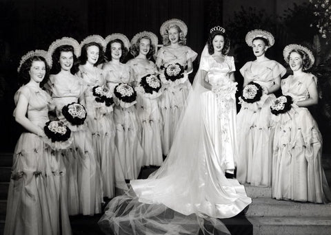 shirley temple wedding with modest wedding dress and bridesmaids gowns with sleeves