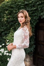 T1986Z modest wedding dress with illusion lace sleeves fitted lace neckline temple bridal gown side close