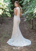 Mon Cheri TR11975 Modest Wedding Dress Back View from A Closet Full of Dresses