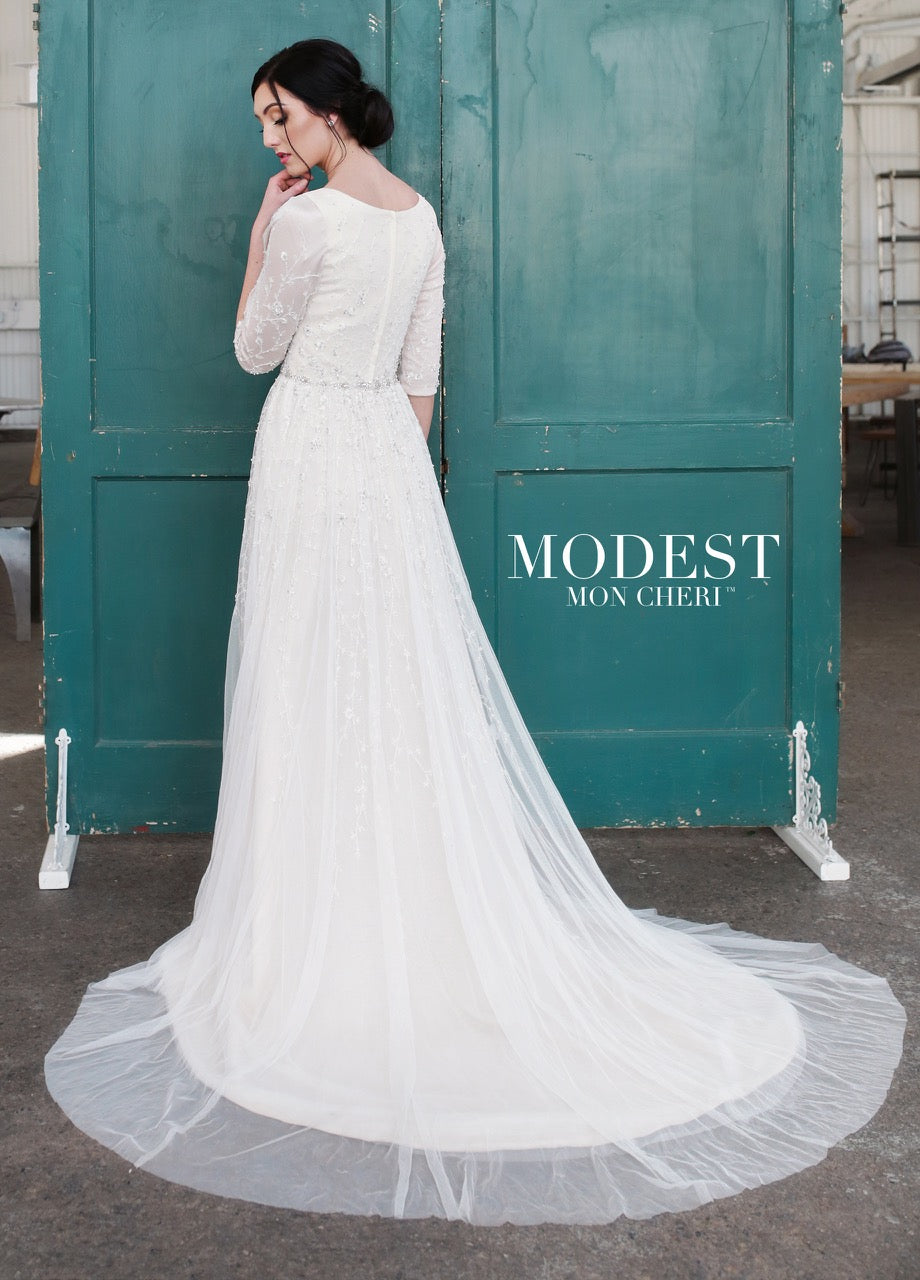 Mon Cheri TR21852 Modest Wedding Dress Back from A Closet Full of Dresses