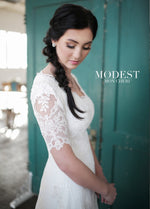 Mon Cheri TR21853 Modest Wedding Dress Close from A Closet Full of Dresses