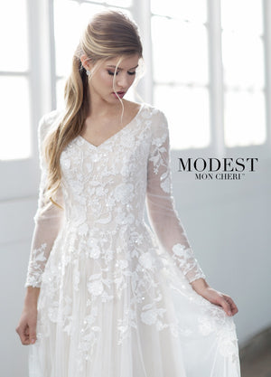 Mon Cheri TR21858 Modest Wedding Dress Close from A Closet Full of Dresses